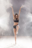 Beautiful female dancer dirty in white flour Royalty Free Stock Images