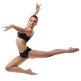 Beautiful female dancer posing in graceful jump Royalty Free Stock Image