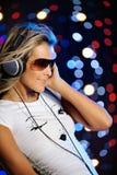 Beautiful female dancing. Vertical image of beautiful female DJ dancing Stock Photos
