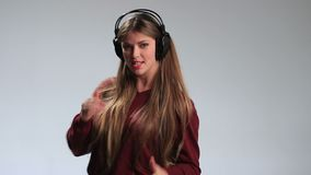 Beautiful female dancing to music in headphones stock video footage