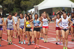 Beautiful female distance runners prepare race Stock Images
