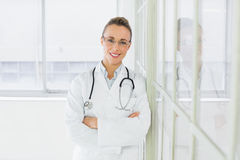 Beautiful female doctor with arms crossed in hospital Stock Images