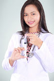 Beautiful female doctor carrying a syringe Royalty Free Stock Photo