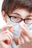 Beautiful female doctor in glasses and mask Royalty Free Stock Photography