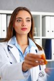 Beautiful female doctor hold in arms pill bottle Stock Photo