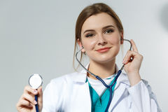Beautiful female doctor put on stethoscope portrait stock image