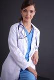 Beautiful female doctor sitting  on stool isolated Stock Image