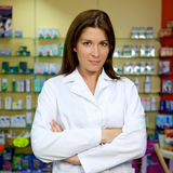 Beautiful female doctor smiling in pharmacy Stock Photos