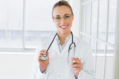 Beautiful female doctor with stethoscope in hospital Stock Images