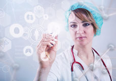 Beautiful female doctor and virtual computer interface Royalty Free Stock Photo