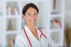 Beautiful female doctor in white clothes background hospital Stock Photos