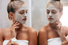 Beautiful female doing beauty treatment after bath Stock Images