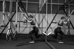Sporty woman doing TRX exercises in the gym Stock Image