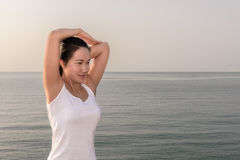Beautiful female doing workout during the morning training on th Stock Photo
