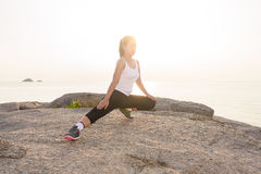 Beautiful female doing workout during the morning training on th Royalty Free Stock Images
