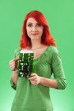 Beautiful female drinking green beer royalty free stock image