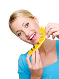 Beautiful female eats the fresh orange Stock Photo