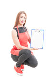 Beautiful female employee holding empty clipboard Royalty Free Stock Images
