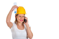 Beautiful female engineer on the phone Stock Photography