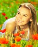 Beautiful female enjoying on the flower field Royalty Free Stock Image