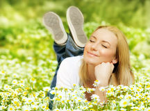 Beautiful female enjoying flower filed Royalty Free Stock Photography