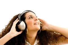 Beautiful female enjoying music Stock Photography