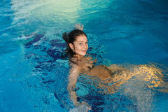 Beautiful female enjoying swimming pool Stock Photos