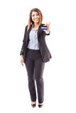 Beautiful female executive with credit card Royalty Free Stock Image