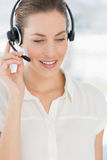 Beautiful female executive with headset Royalty Free Stock Photos