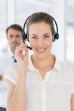 Beautiful female executive with headset Royalty Free Stock Photo
