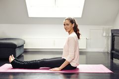 Beautiful female exercising in living room Royalty Free Stock Image