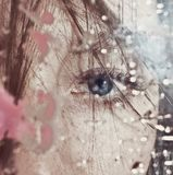 Beautiful female eye through the dirty glass Royalty Free Stock Photo
