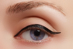 Beautiful female eye with black liner make-up royalty free stock photos