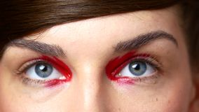 Beautiful female eyes. Close-up of female eyes with colorful make-up stock video footage