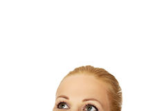 Beautiful female eyes looking up for copyspace or something.  Royalty Free Stock Photos