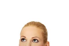 Beautiful female eyes looking up for copyspace or something.  Royalty Free Stock Photo
