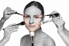 Beautiful female eyes with make-up and brush Stock Photos