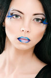 Beautiful female face with blue fashion make-up Stock Photo