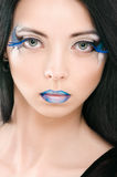 Beautiful female face with blue fashion make-up Royalty Free Stock Images