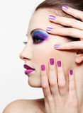 Beautiful female face with bright fashion make-up stock images