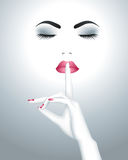 Beautiful female face with finger on her lips Royalty Free Stock Photos