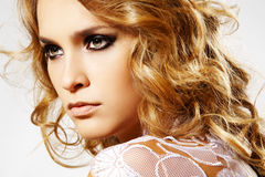 Beautiful female face with make-up and shiny hair stock images