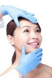 Beautiful female face with Plastic surgery glove Stock Images