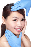 Beautiful female face with Plastic surgery glove Royalty Free Stock Photography