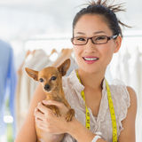 Beautiful female fashion designer with chihuahua Royalty Free Stock Photos