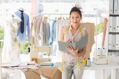 Beautiful female fashion designer with folder Stock Photography