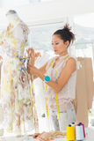 Beautiful female fashion designer working on dress Royalty Free Stock Photo