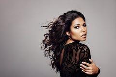 Beautiful female fashion model against grey background royalty free stock photos