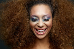 Beautiful female fashion model with colorful make up and curly h Royalty Free Stock Photos