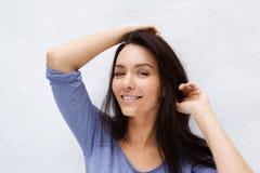 Beautiful female fashion model posing against white background Stock Photos